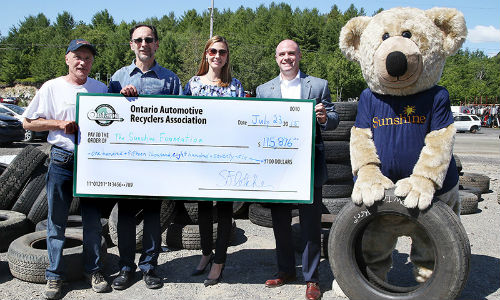Presenting this year's donation to The Sunshine Foundation. From left: Ron Cayer of Rock City Auto Supply, Steve Fletcher of OARA, Heidi Spannbauer of The Sunshine Foundation and Andrew Horsman of OTS.