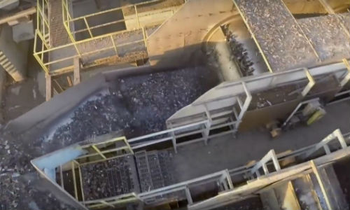 A shredder going full speed ahead. A modern shredder is capable of processing a staggering amount of material per hour.