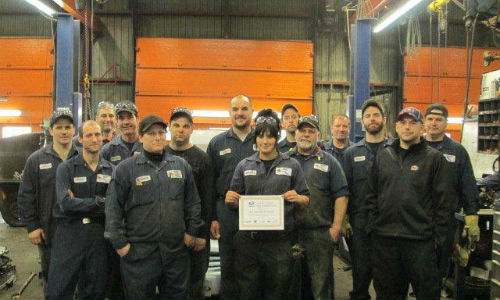 The team at LKQ Lecavalier in Ste-Sophie, Quebec with their Golden Switch Award. The award celebrates five consecutive years of active participation in the Switch Out program.