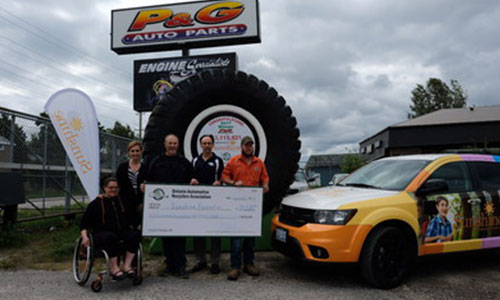 The Sunshine Foundation of Canada receives a donation of $54,528 at the Tire Take Back event, held at P&G Auto Parts. From left to right: Sarah Lashbrook, Heidi Spannbauer, Darrell Pitman, Steve Fletcher and Chris Pitman.