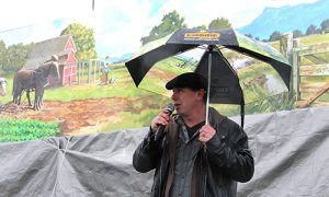 Artist Dean Lauze discusses the 160-foot mural he created for Empire Abbotsford on Friday during an unveiling celebration. (Vikki Hopes/Abbotsford News)